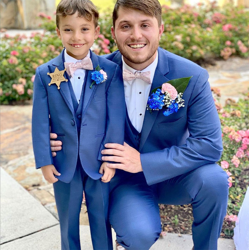 Groom and ring bearer in blue tuxedo